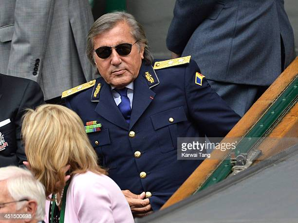 Ilie Nastase attends the Alize Cornet v Eugenie Bouchard match on centre court during day seven of the Wimbledon Championships at Wimbledon on June...