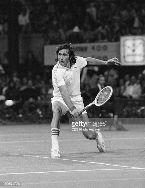 Ilie Nastase during the 1976 US Open tennis tournament that took place on the outdoor clay courts at the Forest Hills Queens in New York Image dated...