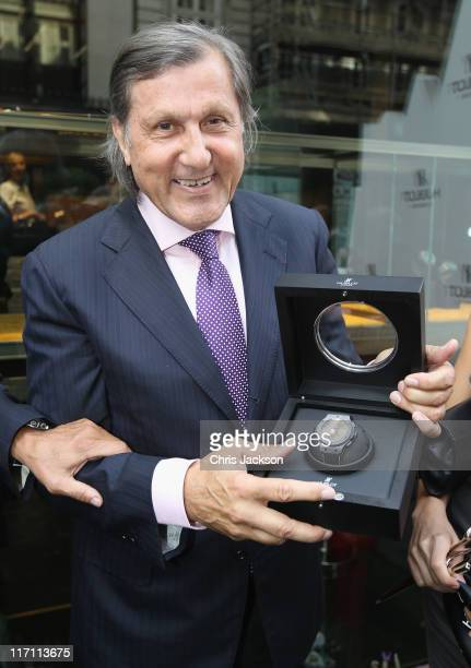 Ilie Nastase holds up his Nastie Bang watch as he attends the Hublot store opening on New Bond Street on June 22 2011 in London England At the...