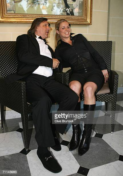 Ilie Nastase of Romania and Kim Clijsters of Belgium ITF World Womens Champion 2005 pose at the Pavillion d'Armenonville after day ten of the French...
