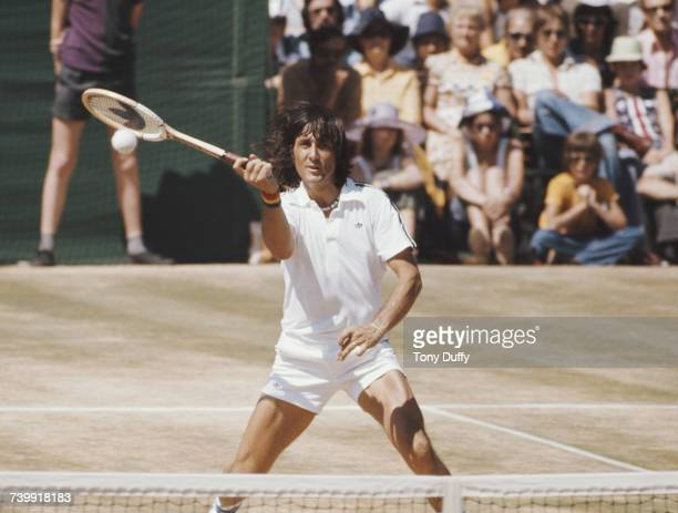 Ilie Nastase of Romania during the Men's Singles Final match against Bjorn Borg at the Wimbledon Lawn Tennis Championship on 3 July 1976 at the All...