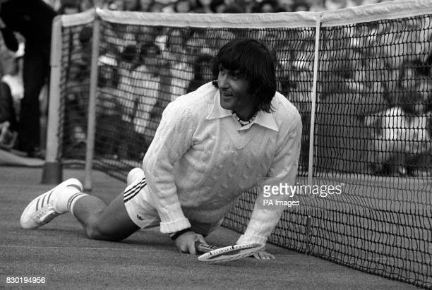 Ilie Nastase of Romania smiles at his own downfall when he slipped on Court 14 during his first round men's single match against Nicky Spear of...