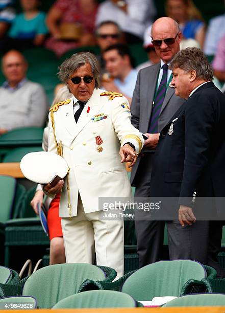 Ilie Nastase takes his seat on Centre Court for the Ladies' Singles Fourth Round match between Serena Williams of the United States and Venus...