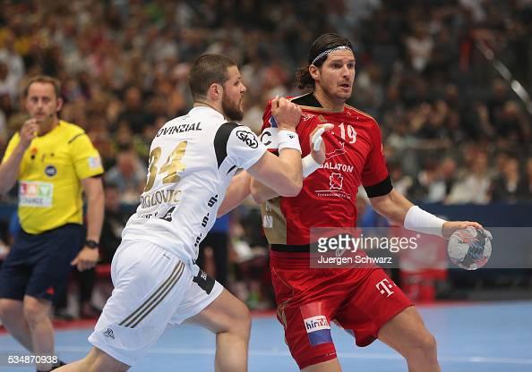 Ilija Brozovic of Kiel blocks Laszlo Nagy of Veszprem during the second semifinal of the EHF Final4 between THW Kiel and MVM Veszprem on May 28 2016...