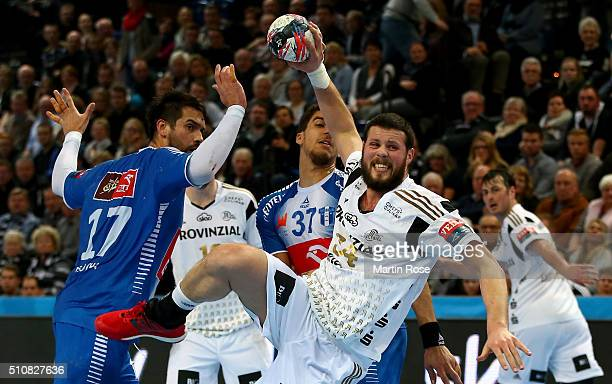 Ilija Brozovic of Kiel challenges Tiago Rocha of Plock for the ball during the VELUX EHF Champions League group A between THW Kiel and Orlen Wisla...