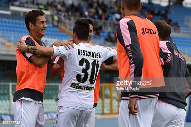 Ilija Nestorovski of Palermo celebrates with team mates after scoring the equalizing goal during the Serie A match between FC Crotone and US Citta di...