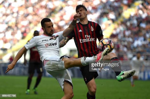 Ilija Nestorovski of Palermo ia challanged by Alessio Romagnoli of Milan during the Serie A match between AC Milan and US Citta di Palermo at Stadio...