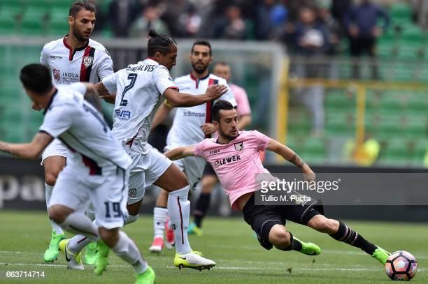 Ilija Nestorovski of Palermo is challenged by Bruno Alves of Cagliari during the Serie A match between US Citta di Palermo and Cagliari Calcio at...