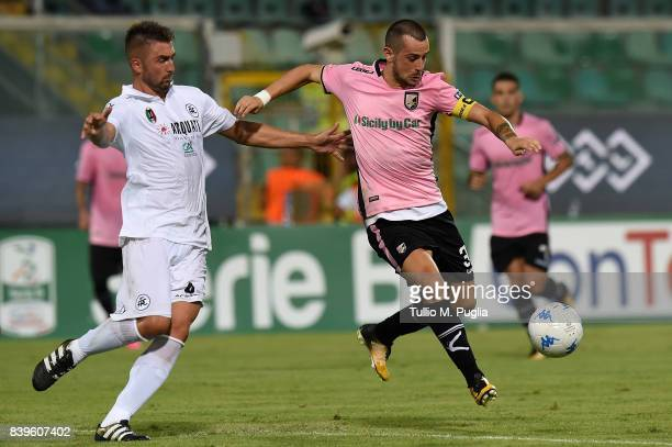 Ilija Nestorovski of Palermo is challenged by Daniele Capelli of Spezia during the Serie B match between US Citta di Palermo and AC Spezia at Stadio...