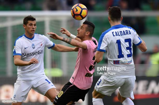 Ilija Nestorovski of Palermo is challenged by Remo Freuler and Mattia Caldara of Atalanta during the Serie A match between US Citta di Palermo and...