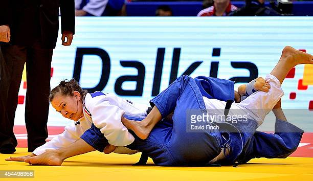 Ilijana Marzok of Germany holds Souad Belakhal of Algeria for ippon helping her team to win 50 during the Chelyabinsk Judo Team World Championships...