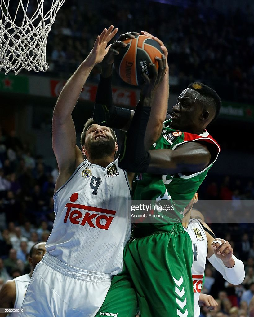 Ilimane Diop of Laboral Kutxa Vitoria Gasteiz in action against Felipe Reyes (L) of Real Madrid during the Turkish Airlines Euroleague Basketball Top 16 Round 6 game between Real Madrid v Laboral Kutxa Vitoria Gasteiz at Barclaycard Center on February 5, 2016 in Madrid, Spain.