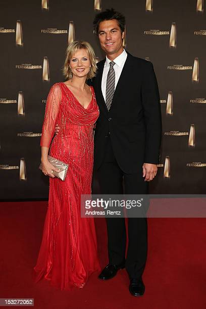 Ilka Essmueller and partner arrive for the German TV Award 2012 at Coloneum on October 2 2012 in Cologne Germany