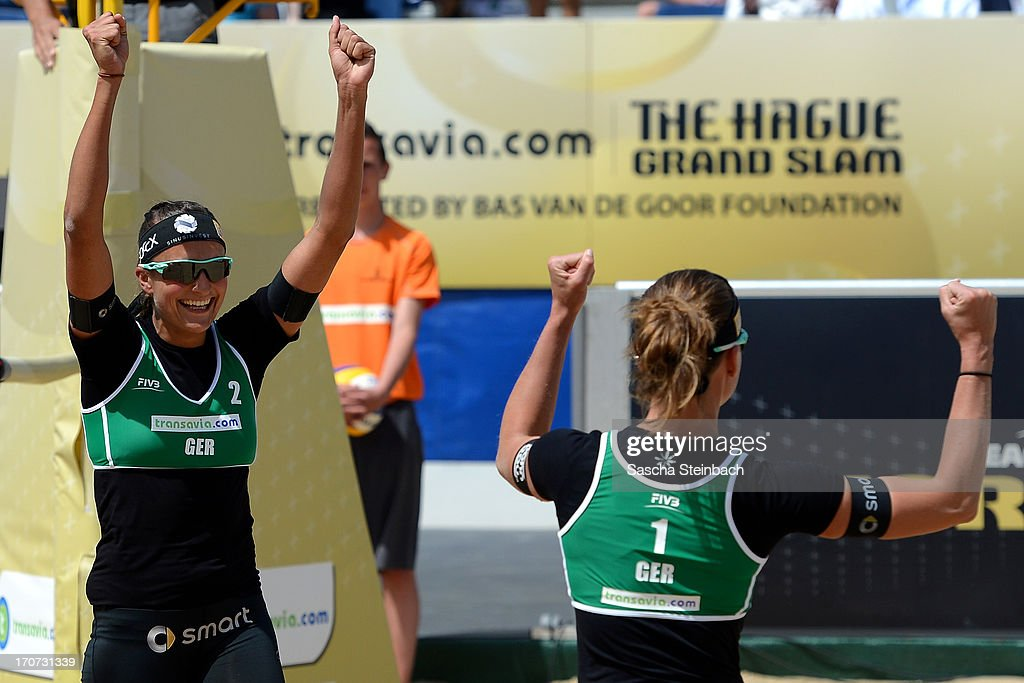 Ilka Semmler (L) and Katrin Holtwick (R) of Germany celebrate winning their 3rd place match during the FIVB Grand Slam final match day at The Hague Beach Stadium on June 16, 2013 in The Hague, Netherlands.