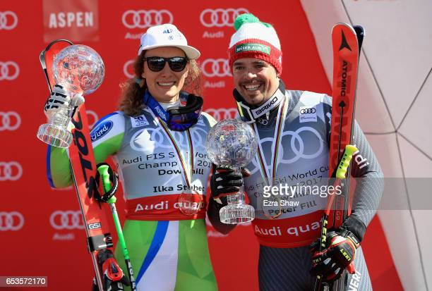 Ilka Stuhec of Slovenia and Peter Fill of Italy celebrate with their seasonending globes after they respectively won the overall World Cup Ladies'...