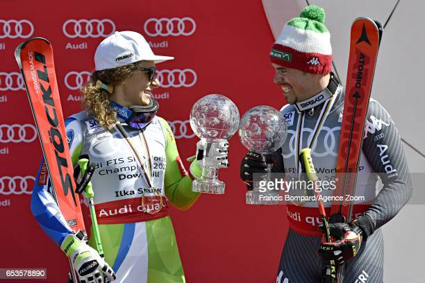 Ilka Stuhec of Slovenia wins the globe in the overall standings Peter Fill of Italy wins the globe in the overall standings during the Audi FIS...