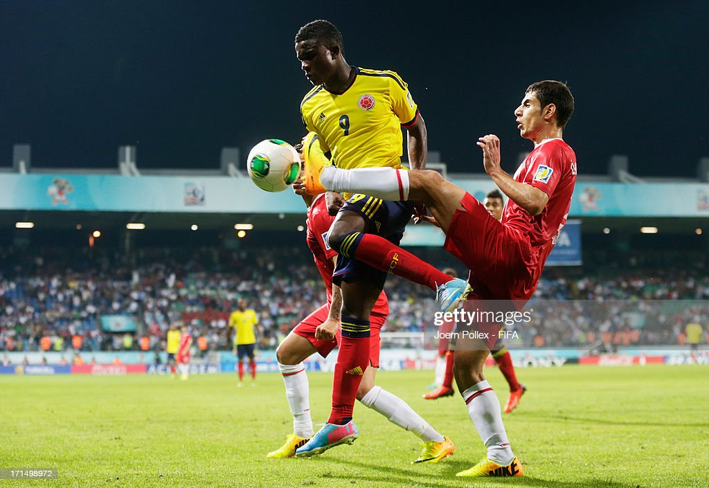 Ilkay Durmus (R) of Turkey and Jhon Cordoba of Colombia compete for the ball during the FIFA U-20 World Cup Group C match between Turkey and Colombia at Yeni Sehir Stadium on June 25, 2013 in Rize, Turkey.