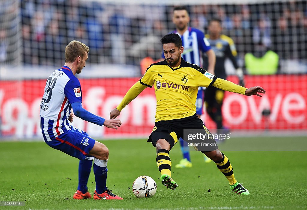 Ilkay Gündogan of Dortmund is challenged by Fabian Lustenberger of Berlin during the Bundesliga match bewteen Hertha BSC and Borussia Dortmund at Olympiastadion on February 6, 2016 in Berlin, Germany.