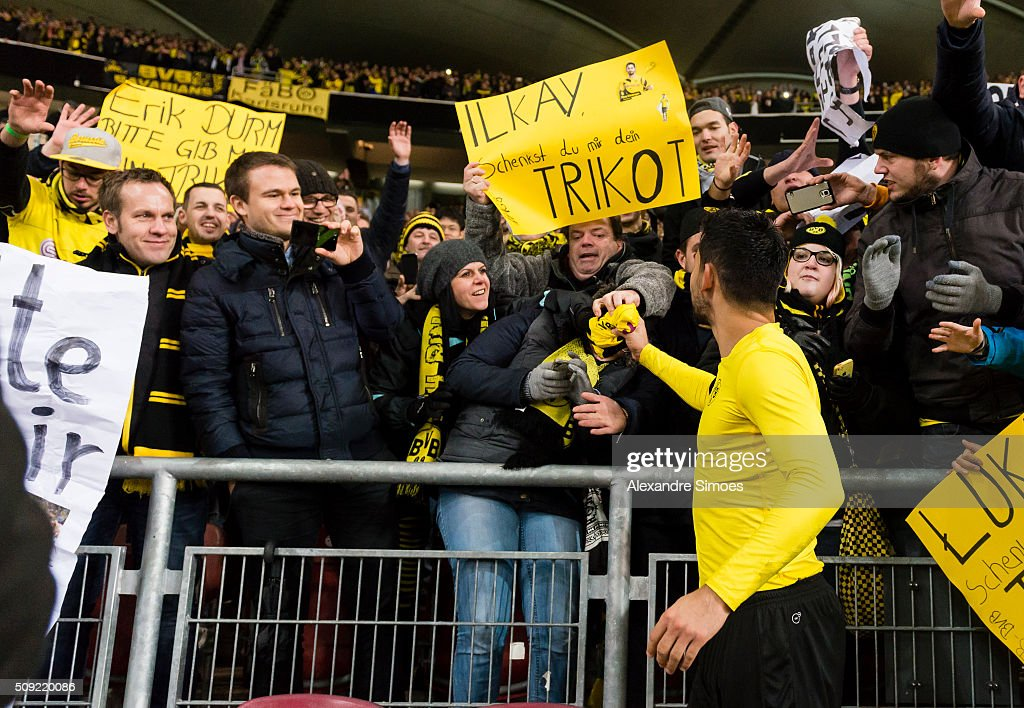 Ilkay Guendogan of Borussia Dortmund gives his shirt to a fan after the final whistle during the DFB Cup match between VfB Stuttgart and Borussia Dortmund at Mercedes-Benz Arena on February 09, 2016 in Stuttgart, Germany.