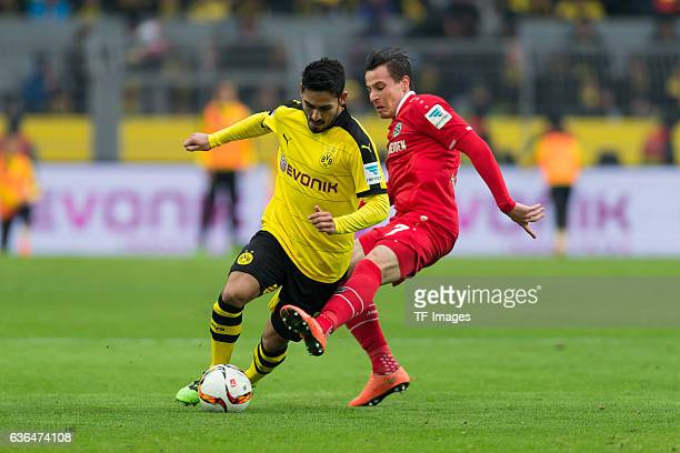 Ilkay Guendogan of Bosussia Dortmund and Edgar PRIB of Hannover 96 battle for the ball during the Bundesliga match between Borussia Dortmund and...