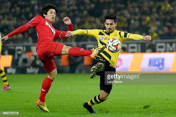 Ilkay Guendogan of Dortmund battles for the ball with Yuya Osako of Koeln during the Bundesliga match between Borussia Dortmund and 1 FC Koeln at...
