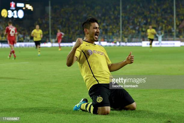 Ilkay Guendogan of Dortmund celebrates after scoring his team's 3rd goal during the DFL Supercup match between Borussia Dortmund and FC Bayern...