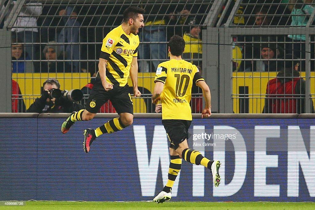 Ilkay Guendogan of Dortmund celebrates his team's first goal with team mate Henrikh Mkhitaryan during the Bundesliga match between Borussia Dortmund...