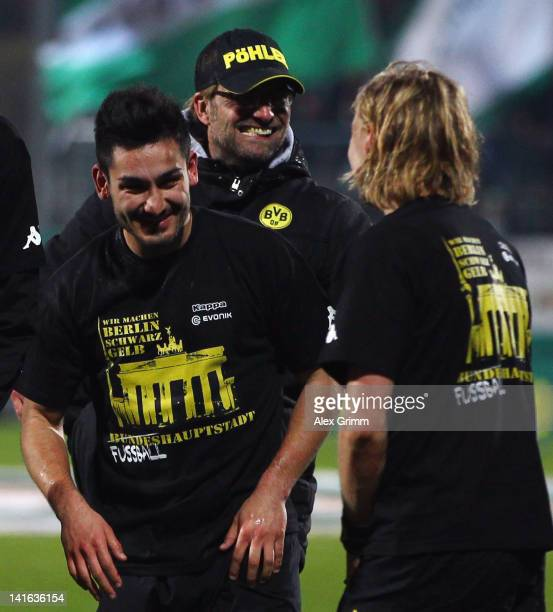 Ilkay Guendogan of Dortmund celebrates with head coach Juergen Klopp and Marcel Schmelzer after winning the DFB Cup semi final match between SpVgg...