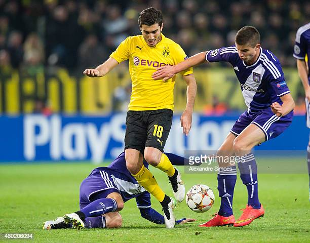 Ilkay Guendogan of Dortmund challenges Dennis Praet and Leander Dendoncker of Anderlecht during the UEFA Champions League first round in group D...