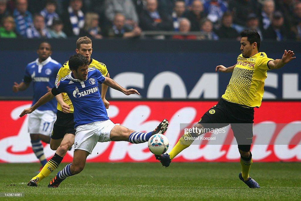 Ilkay Guendogan of Dortmund challenges Raul Gonzalez of Schalke during the Bundesliga match between FC Schalke 04 and Borussia Dortmund at Veltins...