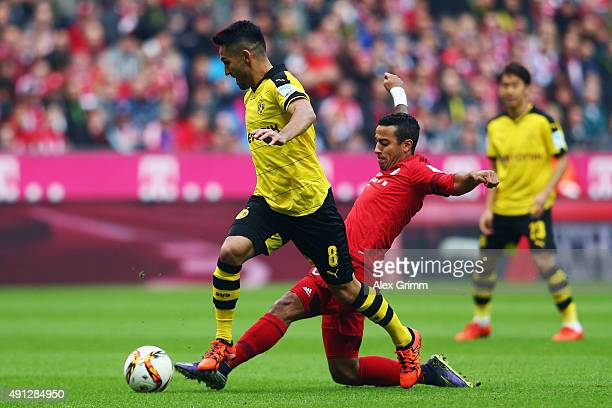Ilkay Guendogan of Dortmund is challenged by Thiago Alcantara of Muenchen during the Bundesliga match between FC Bayern Muenchen and Borussia...