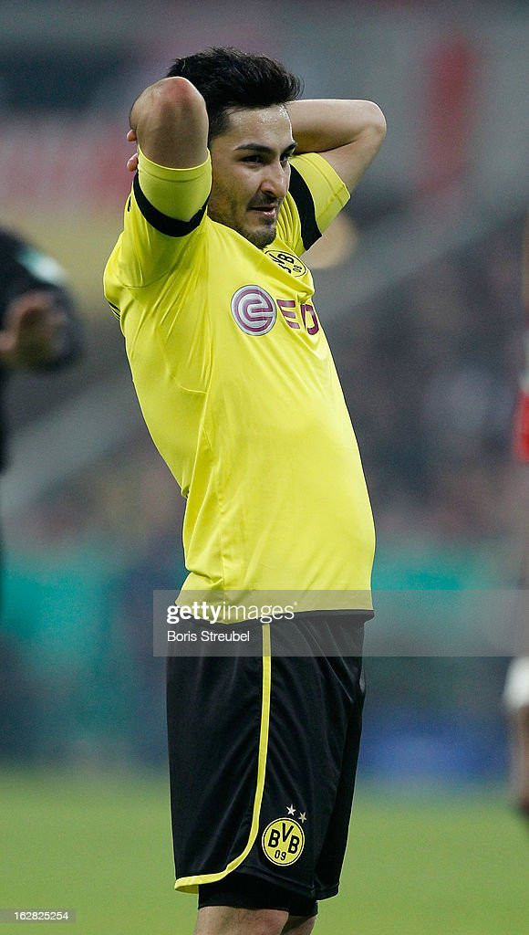 Ilkay Guendogan of Dortmund reacts after loosing the DFB Cup Quarter Final match between FC Bayern Muenchen and Borussia Dortmund at Allianz Arena on February 27, 2013 in Munich, Germany.