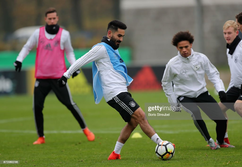 Ilkay Guendogan of Germany battle for the ball with Leroy Sane of Germany during a training session of the German National team at Stadion auf dem Wurfplatz on November 9, 2017 in Berlin, Germany.