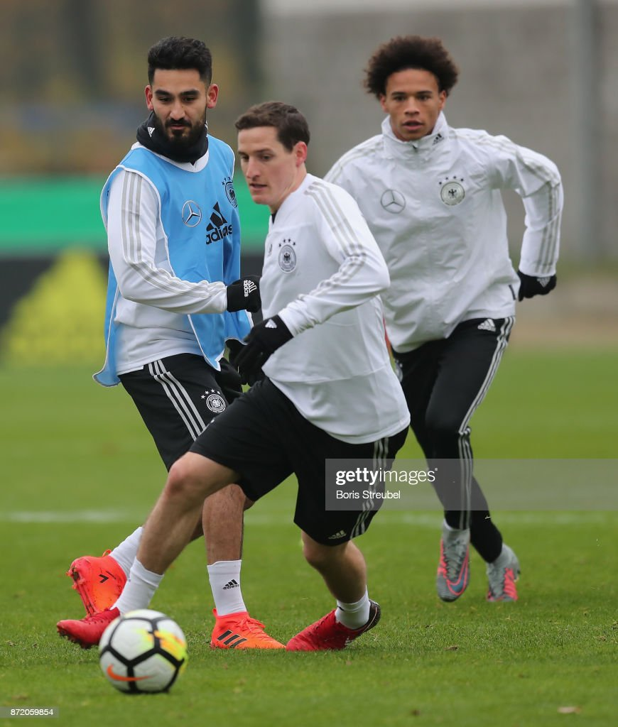 Ilkay Guendogan of Germany battle for the ball with Sebastian Rudy of Germany during a training session of the German National team at Stadion auf dem Wurfplatz on November 9, 2017 in Berlin, Germany.