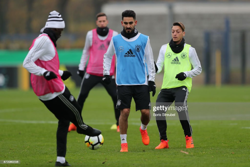 Ilkay Guendogan of Germany battles for the ball with Antonio Ruediger of Germany during a training session of the German National team at Stadion auf dem Wurfplatz on November 9, 2017 in Berlin, Germany.