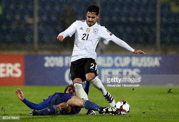 Ilkay Guendogan of Germany battles for the ball with Luca Tosi of San Marino during the FIFA 2018 World Cup Qualifier between San Marino and Germany...