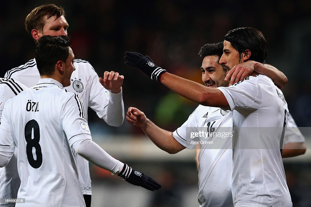 Ilkay Guendogan (2R) of Germany celebrates his team's third goal with team mates <a gi-track='captionPersonalityLinkClicked' href=/galleries/search?phrase=Sami+Khedira&family=editorial&specificpeople=2513712 ng-click='$event.stopPropagation()'>Sami Khedira</a>, <a gi-track='captionPersonalityLinkClicked' href=/galleries/search?phrase=Mesut+Oezil&family=editorial&specificpeople=764075 ng-click='$event.stopPropagation()'>Mesut Oezil</a> and <a gi-track='captionPersonalityLinkClicked' href=/galleries/search?phrase=Per+Mertesacker&family=editorial&specificpeople=207135 ng-click='$event.stopPropagation()'>Per Mertesacker</a> during the FIFA 2014 World Cup qualifier between Germany and Kazakhstan at Grundig-Stadion on March 26, 2013 in Nuremberg, Germany.
