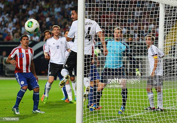 Ilkay Guendogan of Germany heads the ball of the goal line during the international friendly match between Germany and Paraguay at FritzWalterStadium...