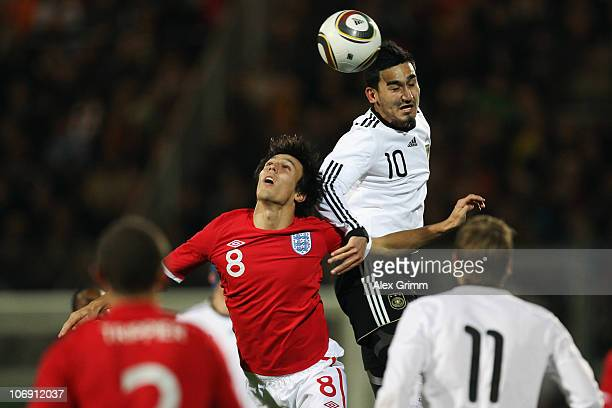 Ilkay Guendogan of Germany outjumps Jack Cork of England during the U21 international friendly match between Germany and England at the Brita Arena...