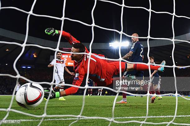 Ilkay Guendogan of Germany scores past David Marshall of Scotland for his team's third goal during the UEFA EURO 2016 Qualifier Group D match between...