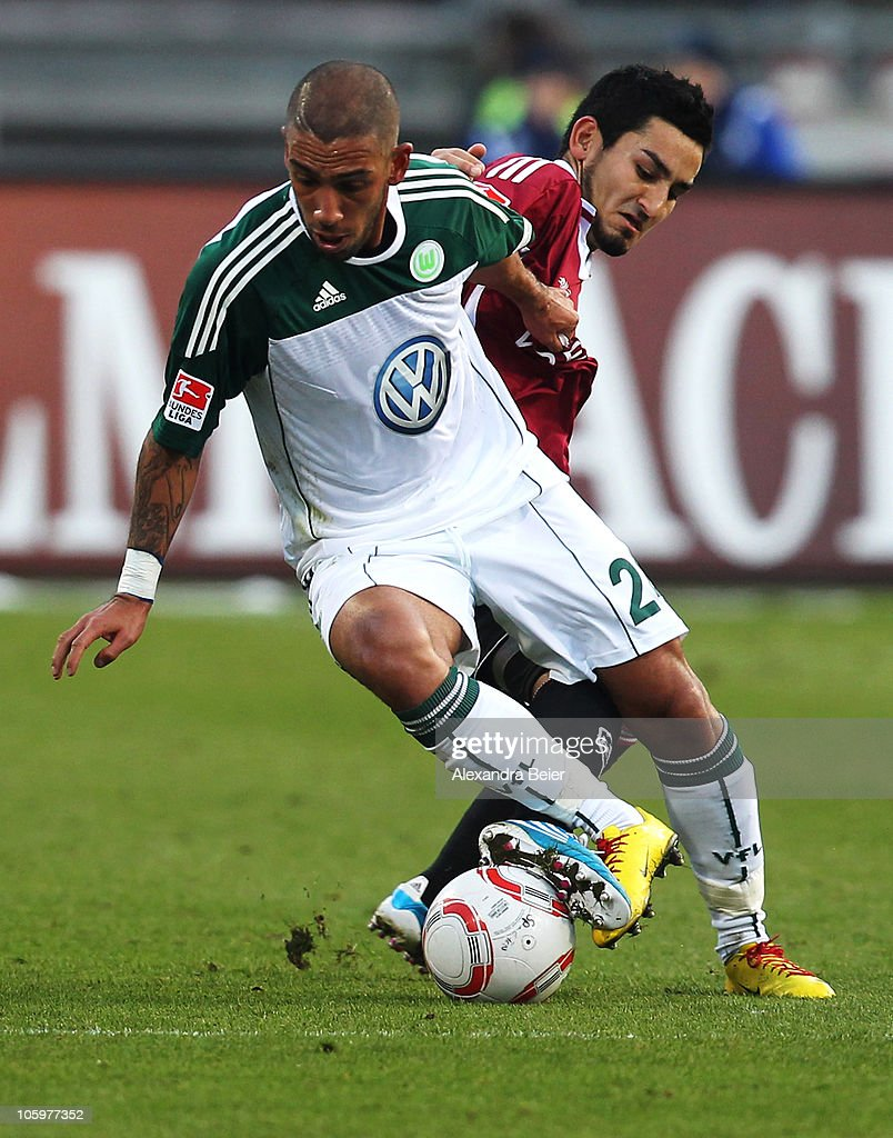 Ilkay Guendogan (R) of Nuernberg fights for the ball with <a gi-track='captionPersonalityLinkClicked' href=/galleries/search?phrase=Ashkan+Dejagah&family=editorial&specificpeople=4024305 ng-click='$event.stopPropagation()'>Ashkan Dejagah</a> of Wolfsburg during the Bundesliga match between 1. FC Nuernberg and VfL Wolfsburg at Easy Credit Stadium on October 23, 2010 in Nuremberg, Germany.