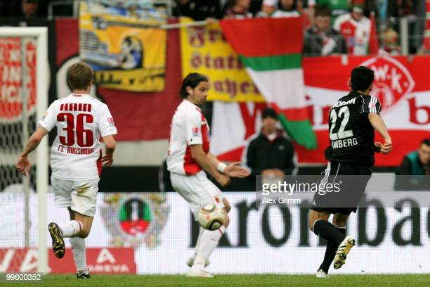 Ilkay Guendogan of Nuernberg scores his team's first goal against Sandor Torghelle and Stephan Hain of Augsburg during the Bundesliga play off leg...