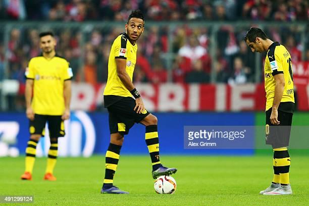 Ilkay Guendogan PierreEmerick Aubameyang and Henrikh Mkhitaryan of Dortmund react after Robert Lewandowski of Muenchen scored his team's third goal...