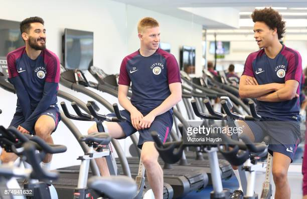 Ilkay Gundogan Kevin De Bruyne and Leroy Sane talk during training at Manchester City Football Academy on November 16 2017 in Manchester England