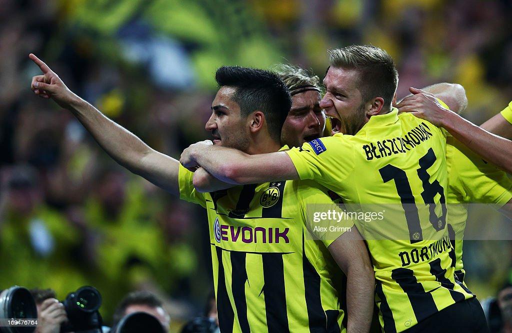 Ilkay Gundogan of Borussia Dortmund celebrates with teammate Jakub Blaszczykowski after scoring a goal from the penalty spot during the UEFA...
