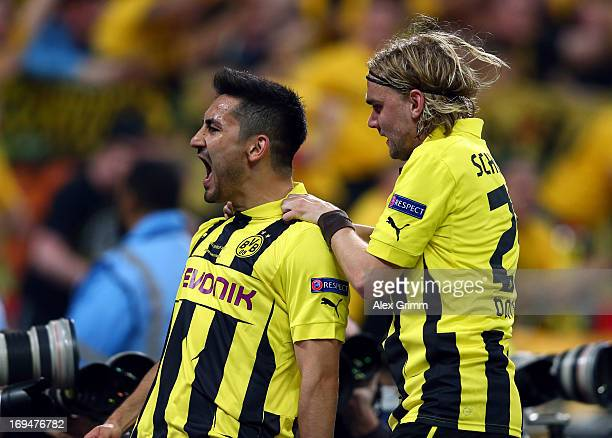 Ilkay Gundogan of Borussia Dortmund celebrates with teammate Marcel Schmelzer after scoring a goal from the penalty spot during the UEFA Champions...