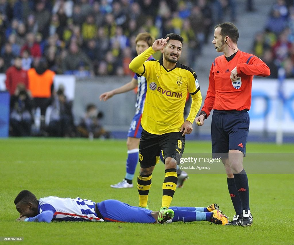 Ilkay Gundogan (C) of Dortmund gestures as Salomon Kalou of Berlin lies on the pitch during the Bundesliga match between Hertha BSC and Borussia Dortmund at Olympiastadion on February 6, 2016 in Berlin, Germany.