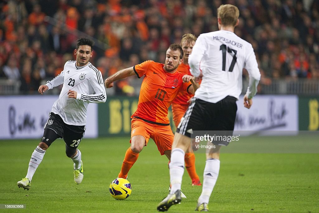 Ilkay Gundogan of Germany, Rafael van der Vaart of Holland, Per Mertesacker of Germany during the Friendly match between Holland and Germany at the Amsterdam Arena on November 14, 2012 in Amsterdam, The Netherlands.