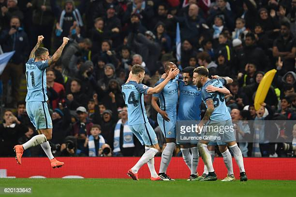 Ilkay Gundogan of Manchester City celebrates with team mates as he scores their third goal during the UEFA Champions League Group C match between...