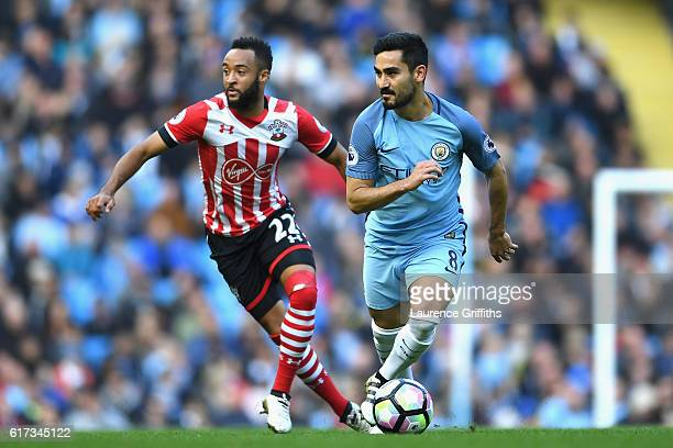 Ilkay Gundogan of Manchester City is closed down by Nathan Redmond of Southampton during the Premier League match between Manchester City and...